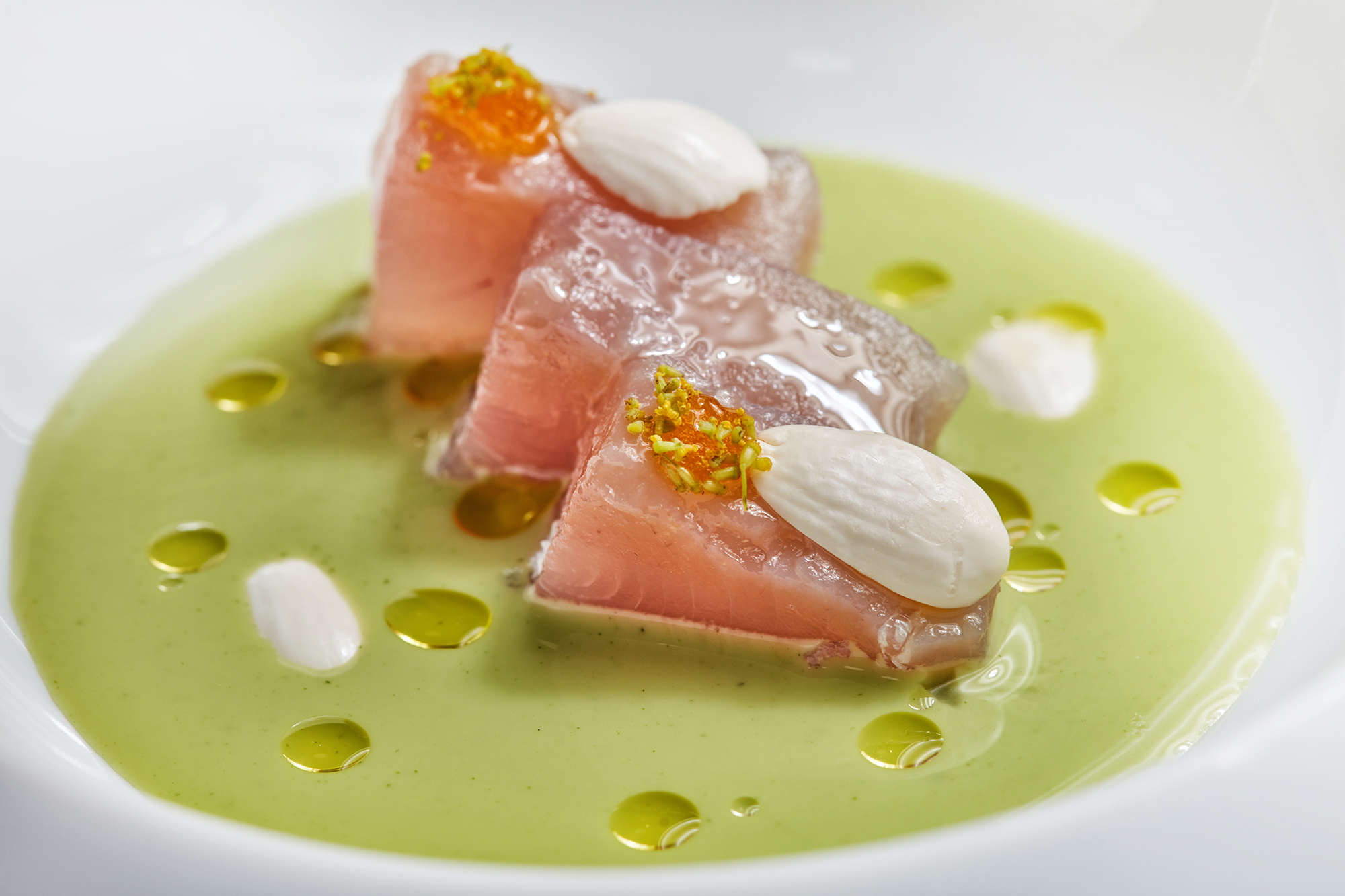 Cream of dill and almonds with bonito and duck egg yolk
